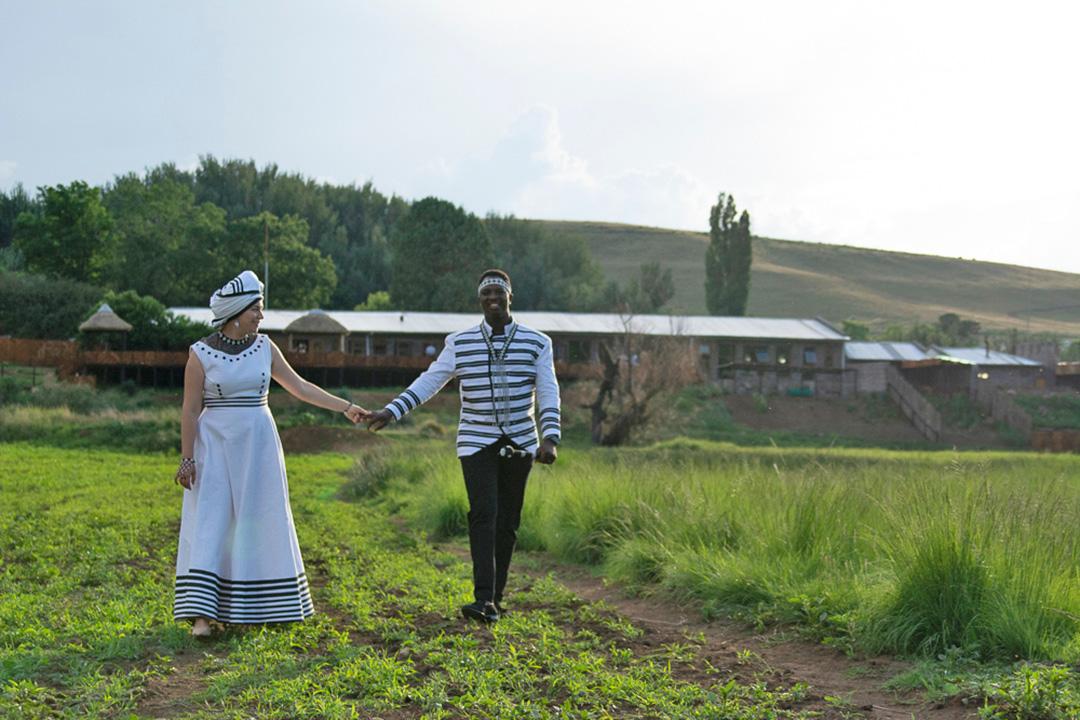 Alpine Swift Trails happy wedding couple walking on open field